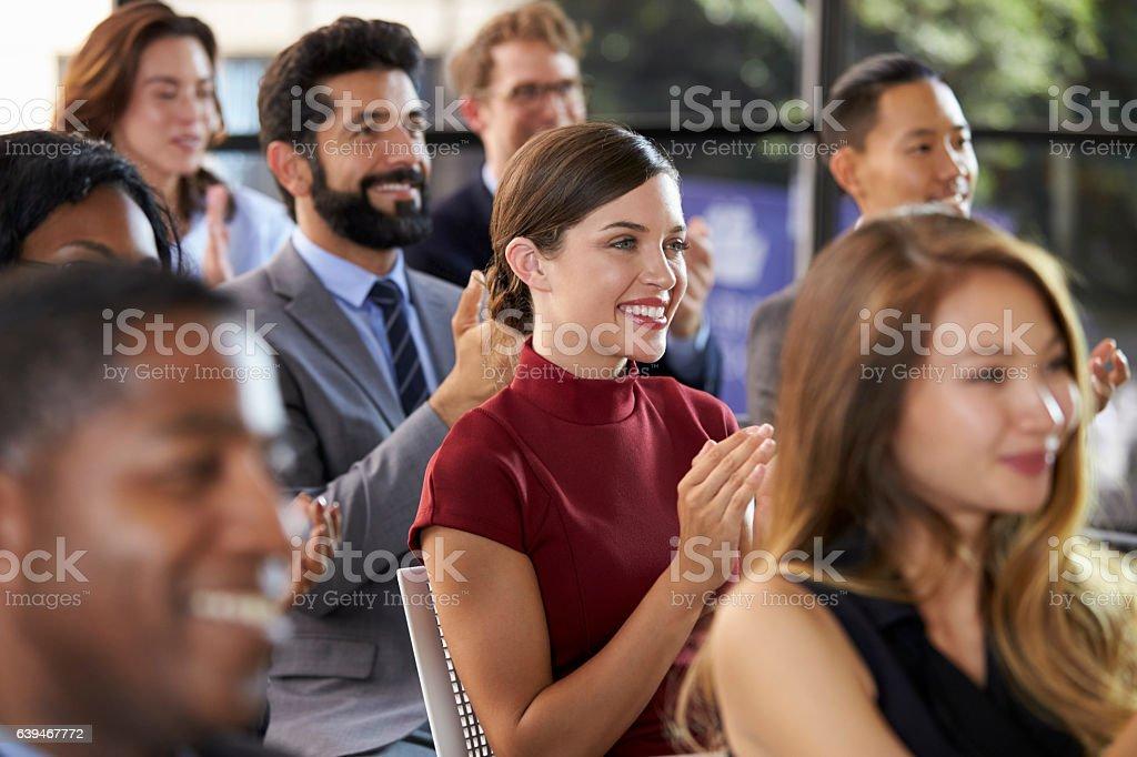 Audience applauding at a business seminar, close up stock photo