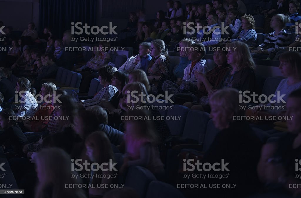 Audience applauding, during a spectacular event stock photo