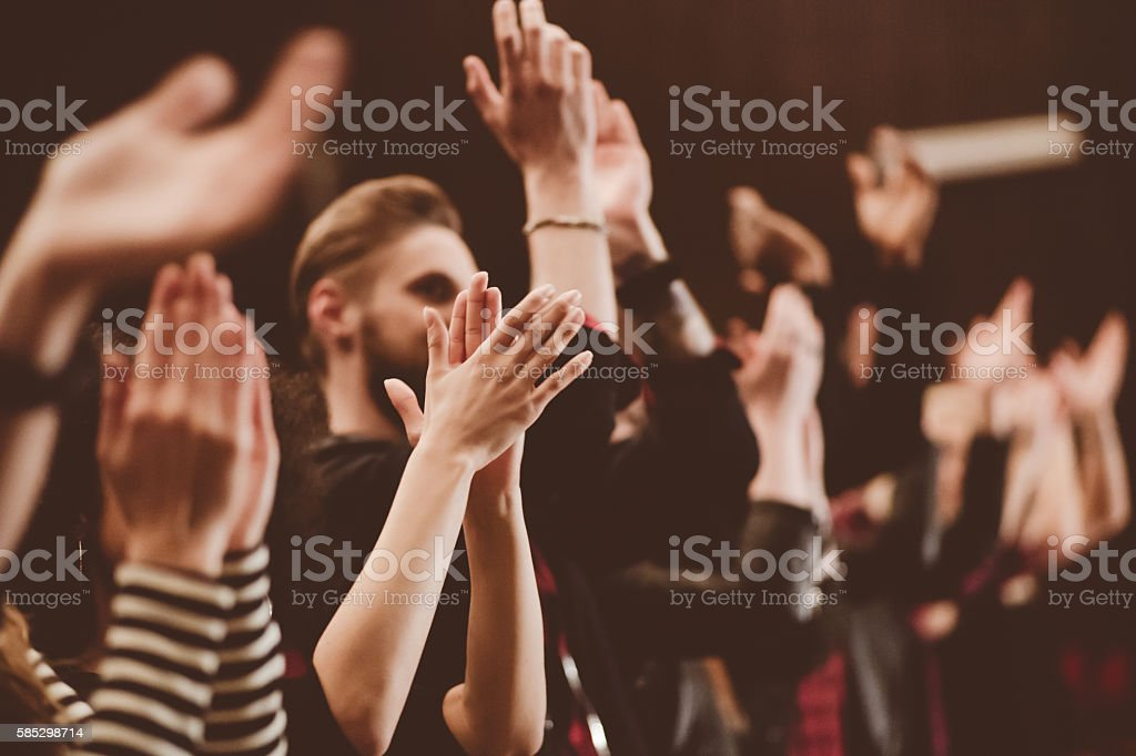 Group of people clapping hands in the theater, close up of hands....