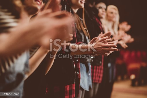 585298714 istock photo Audience applauding in the theater 625222762