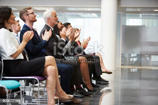 600073884 istock photo Audience Applauding Speaker After Conference Presentation 600072188