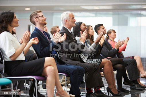 600073884 istock photo Audience Applauding Speaker After Conference Presentation 600072228