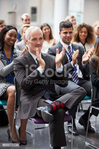 600073884 istock photo Audience Applauding Speaker After Conference Presentation 600072238
