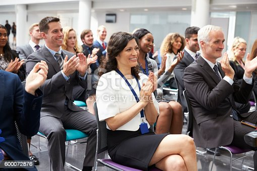 600073884 istock photo Audience Applauding Speaker After Conference Presentation 600072876