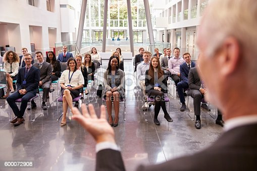 600073884 istock photo Audience Applauding Speaker After Conference Presentation 600072908