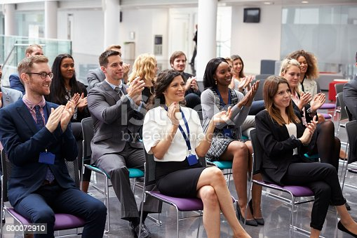 600073884 istock photo Audience Applauding Speaker After Conference Presentation 600072910