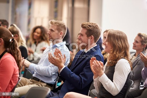 600073884 istock photo Audience Applauding Speaker After Conference Presentation 600073810