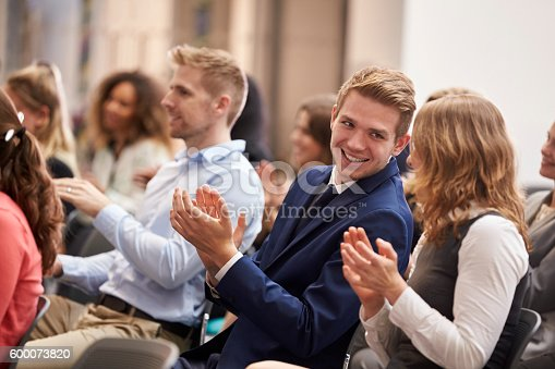 600073884 istock photo Audience Applauding Speaker After Conference Presentation 600073820