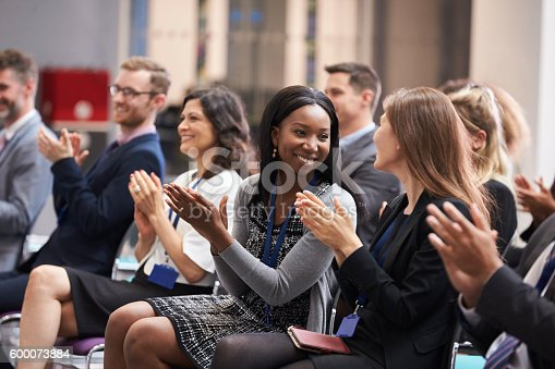 istock Audience Applauding Speaker After Conference Presentation 600073884