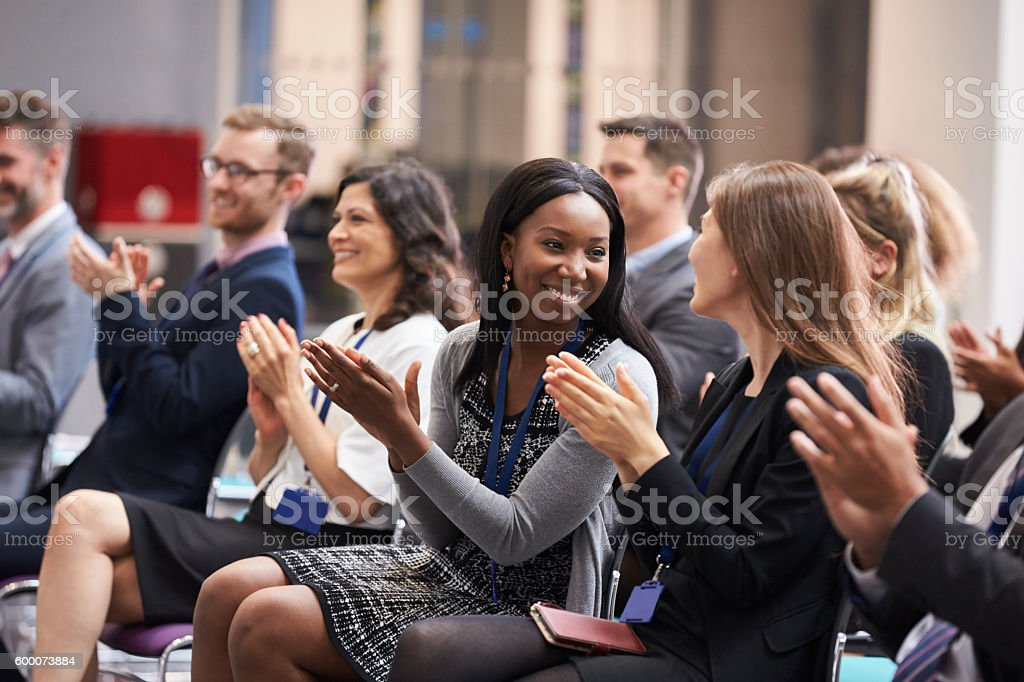 Audience Applauding Speaker After Conference Presentation - foto de stock