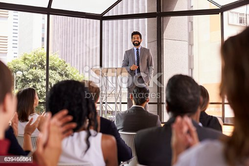 862720340 istock photo Audience applauding speaker at a business seminar 639466664