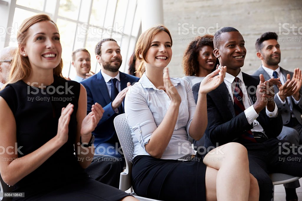 Audience Applauding Speaker At Business Conference Audience Applauding Speaker At Business Conference 20-29 Years Stock Photo