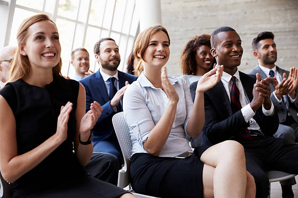 Audience Applauding Speaker At Business Conference foto