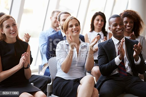 505413934 istock photo Audience Applauding Speaker At Business Conference 505411990