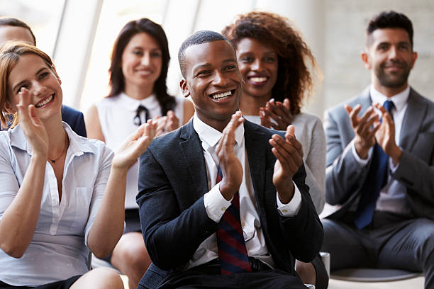 Audience Applauding Speaker At Business Conference stock photo