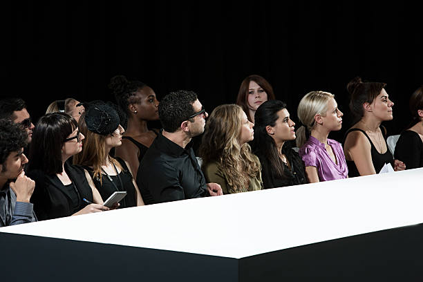 Audience at fashion show watching empty catwalk  ramp stock pictures, royalty-free photos & images