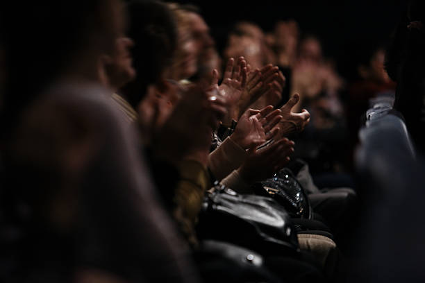 Audience clapping their hands stock photo