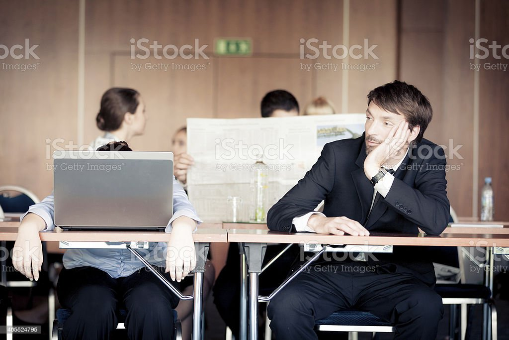 audience getting bored stock photo