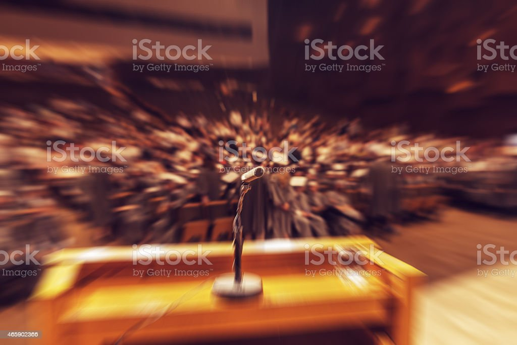 Audience in a big concert hall during graduation ceremony. Micro stock photo