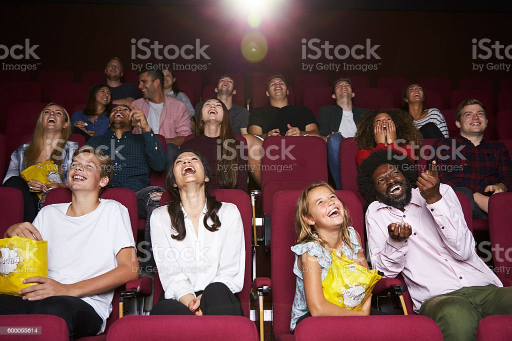 Audience In Cinema Watching Comedy Film stock photo