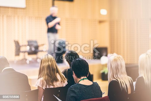 938409136 istock photo Audience listening to lecturer on stage 938255896