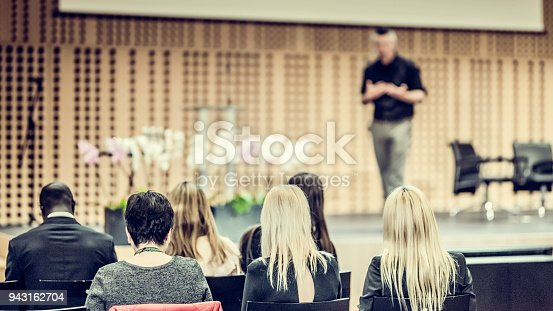 938409136 istock photo Audience listening to lecturer on stage 943162704