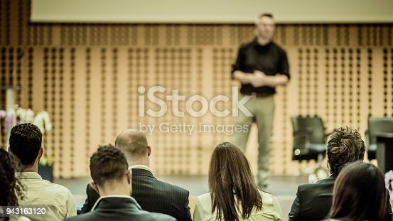 938409136 istock photo Audience listening to lecturer on stage 943163120