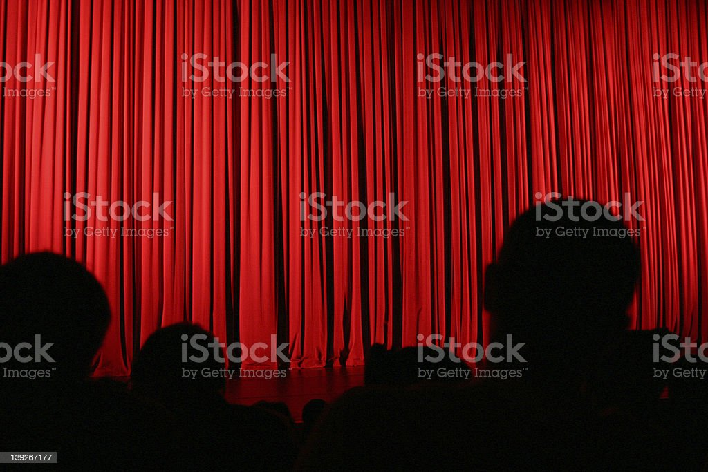 Audience silhouette and curtain stock photo