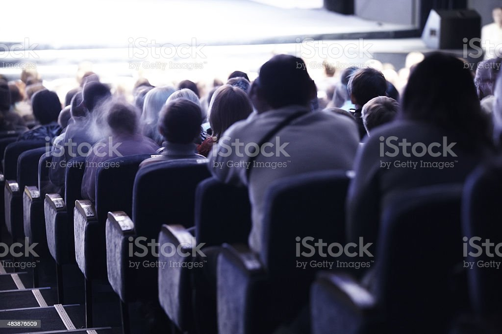 Audience sitting in tiered seating stock photo