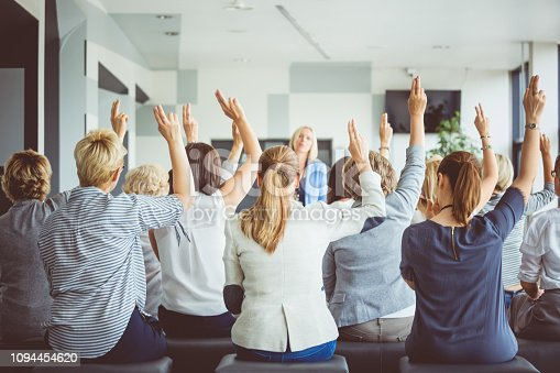 933450738 istock photo Audience voting during seminar 1094454620