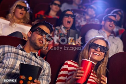 187095683 istock photo Audience watching 3D film at cinema 188007953
