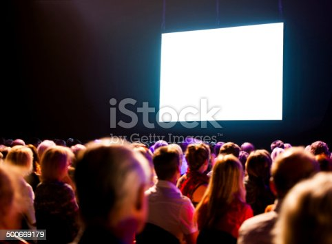 istock Audience watching a bright blank screen 500669179