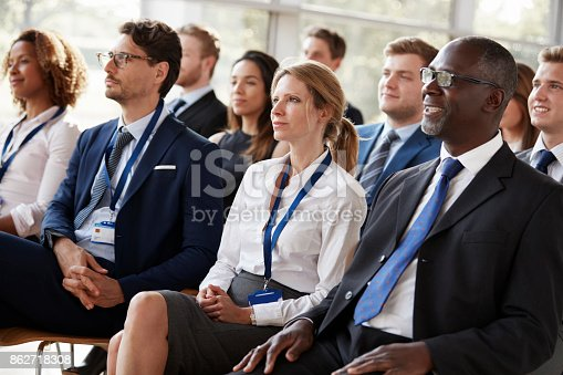 istock Audience watching a business conference 862718308