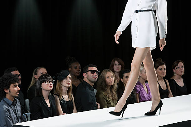 Audience watching model on catwalk at fashion show, low section  ramp stock pictures, royalty-free photos & images