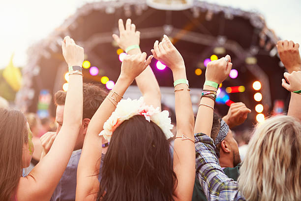 audience with hands in the air at a music festival - festival stockfoto's en -beelden