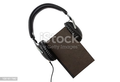 istock Audio book. Black book and headphones set isolated on white background, top view 1051617562