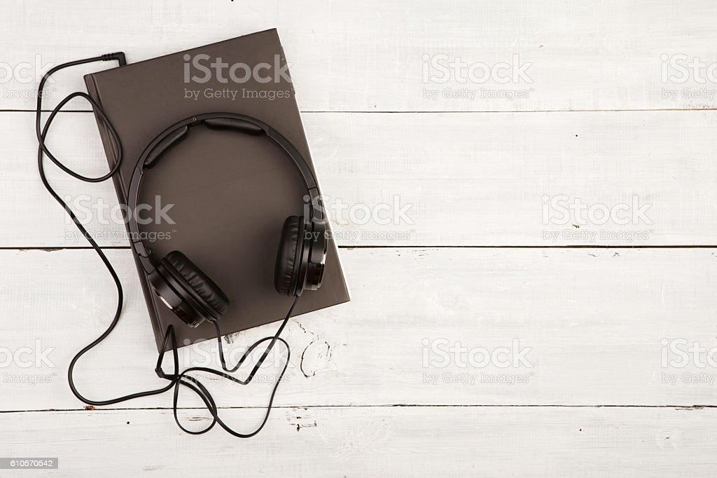 Audio book concept with black book and headphones stock photo