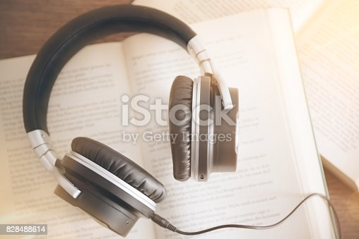 istock audio book concept with rustic wooden table background 828488614