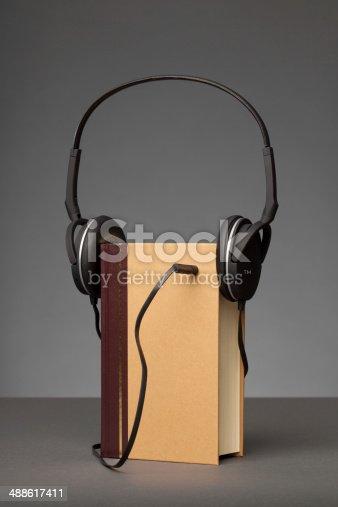 istock Audio Book on Grey Background, Headphones 488617411