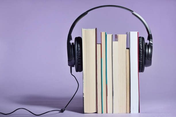 Audio books concept with books and headphones stock photo