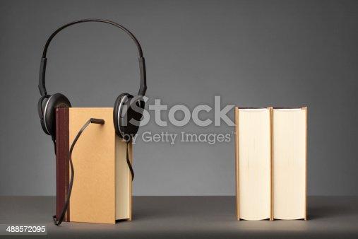 istock Audio Books on Grey Background 488572095