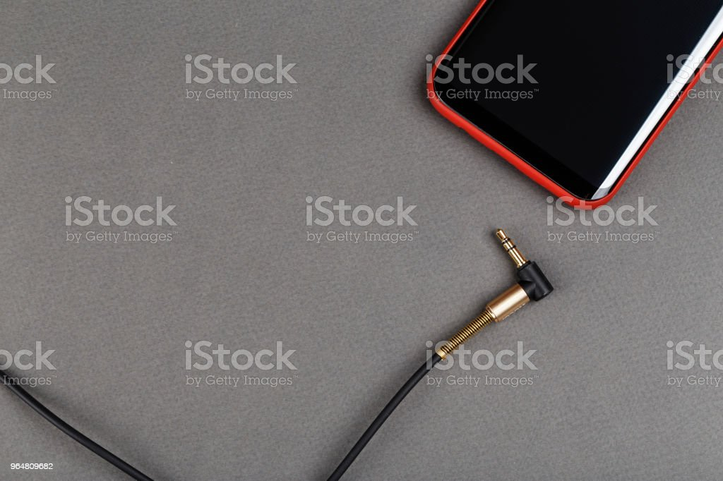 audio cable mini jack and mobile phone royalty-free stock photo