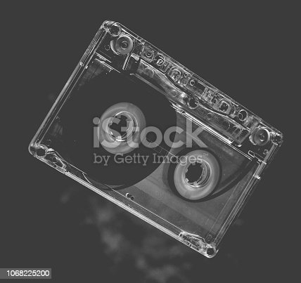 istock Audio cassette levitation. Retro media technology from the 80s. Mystical light. 1068225200