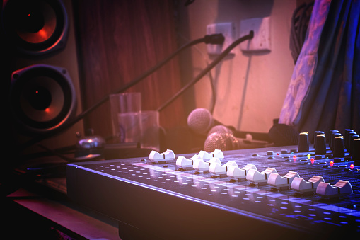 Audio control buttons for professional sound engineers. Selective focus.