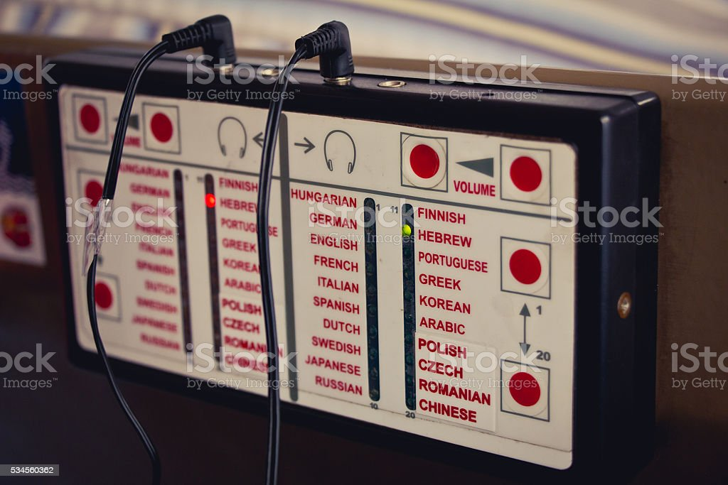 Audio guide device that plays information in different languages stock photo