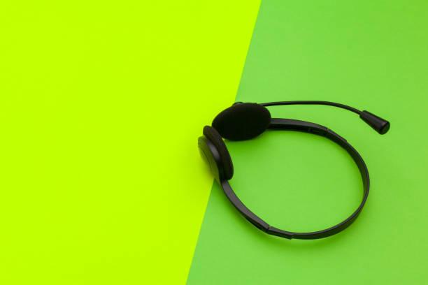 audio headset on color background - call center стоковые фото и изображения