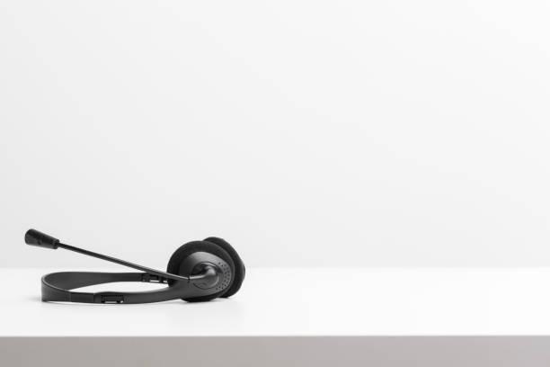 audio headset on the table - call center стоковые фото и изображения