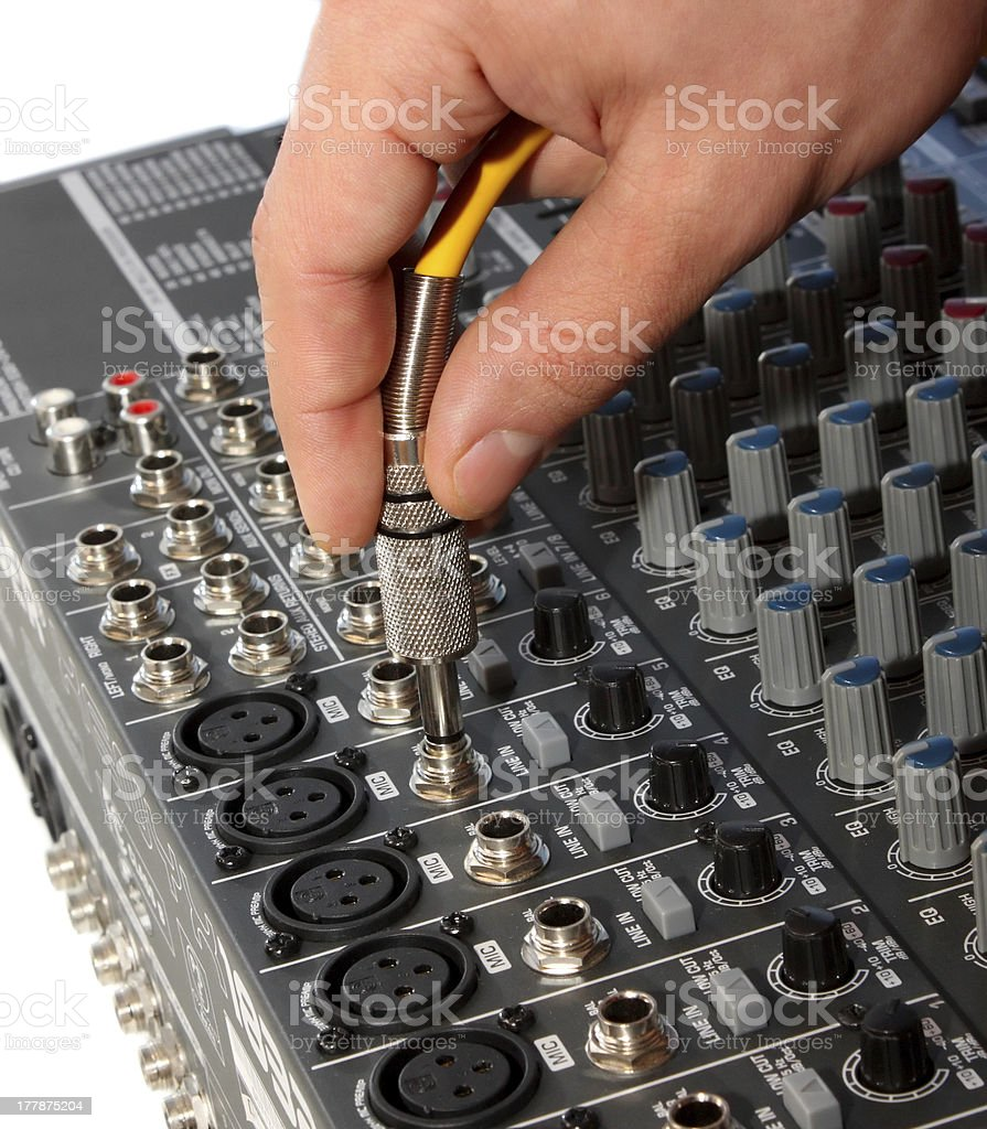 audio jack and hand royalty-free stock photo