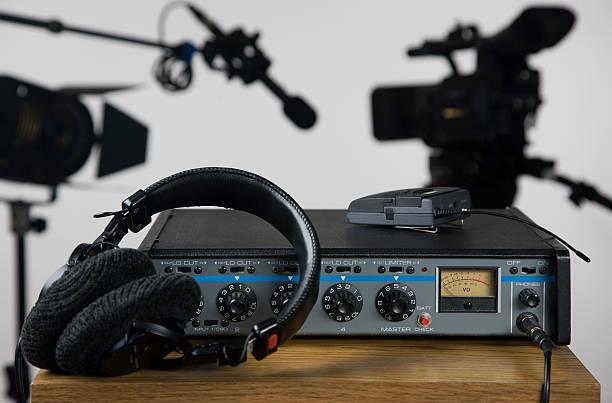 Audio mixer and head phones stock photo