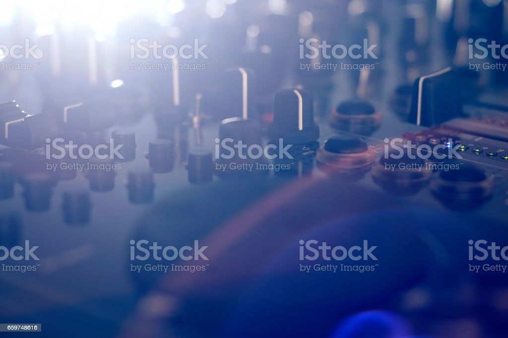 DJ audio mixer with side light and lens flare stock photo